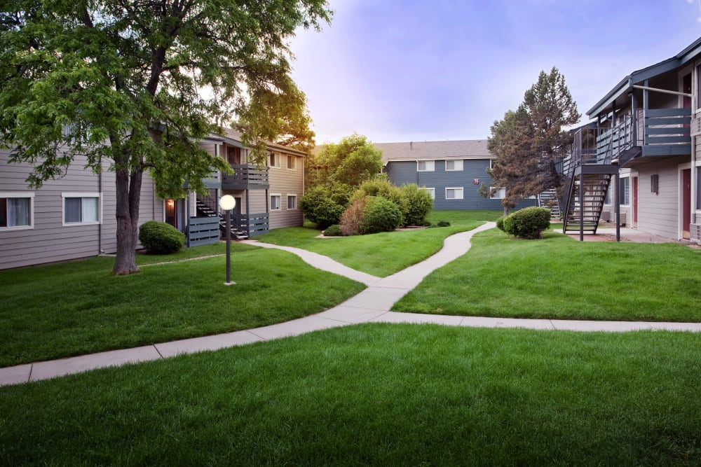 Walkways through well-manicured lawns at Hampden Heights Apartments in Denver, Colorado