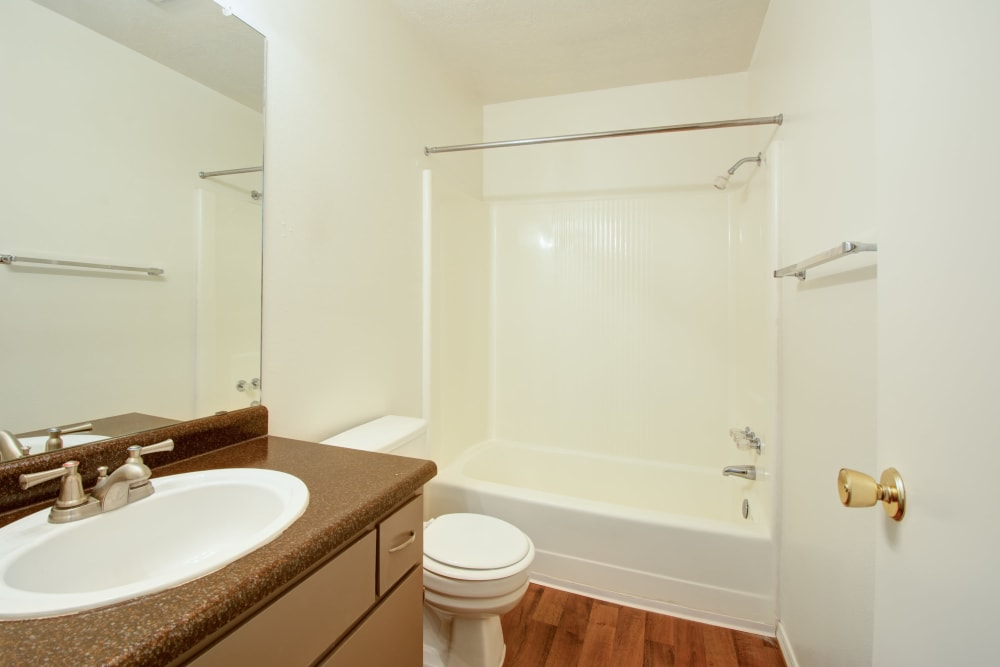 Bathroom with a vanity mirror and an oval tub at Mesa Del Oso in Albuquerque, New Mexico