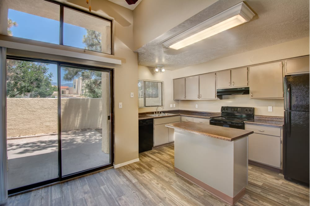 Kitchen with wood-style flooring at Mesa Del Oso in Albuquerque, New Mexico