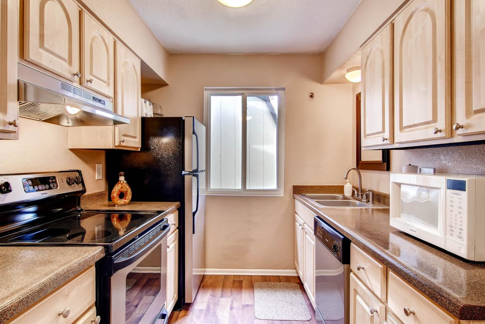 Spacious kitchen at Arvada Green Apartment Homes in Arvada, Colorado