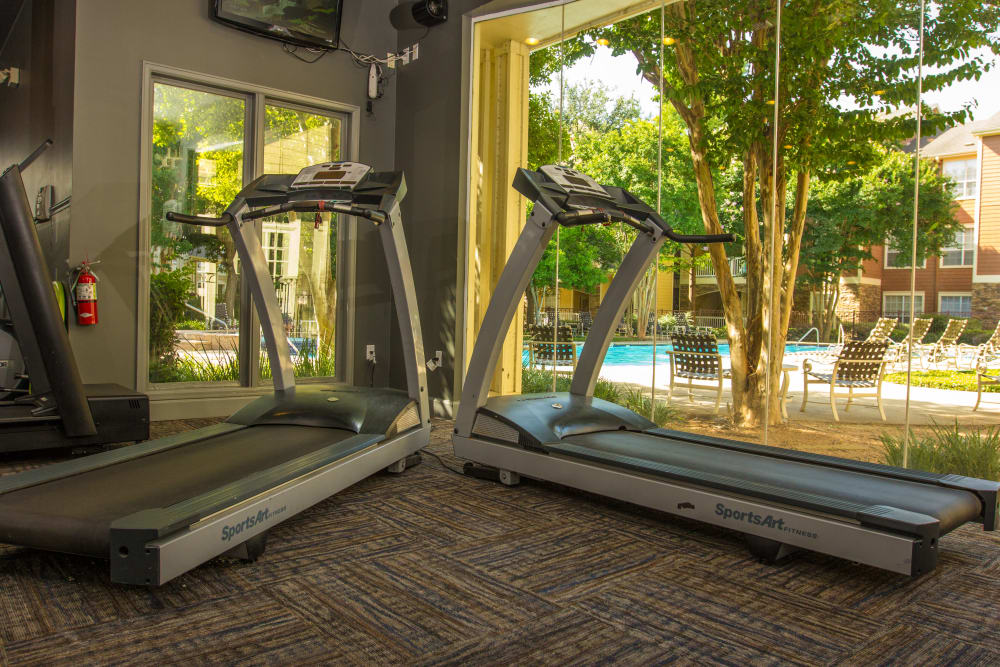 Treadmills and more in the fitness center at The Lodge at River Park in Fort Worth, Texas