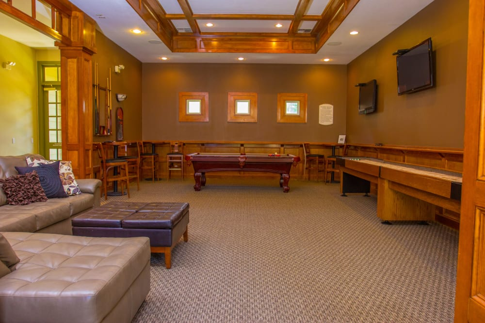 Billiards table and shuffleboard in the resident clubhouse at The Lodge at River Park in Fort Worth, Texas