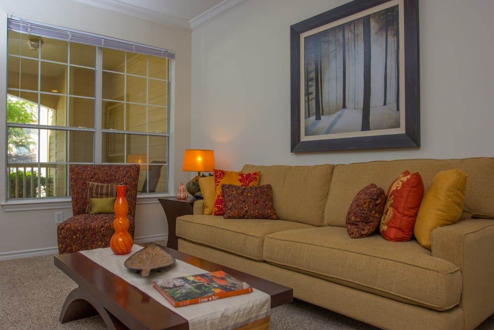 Comfortable furnishings in the living area of a model home at The Lodge at River Park in Fort Worth, Texas