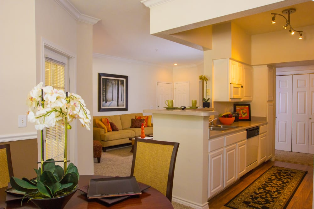 Modern decor in the dining and living areas of a model home at The Lodge at River Park in Fort Worth, Texas