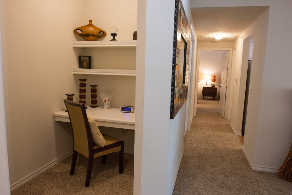 Spacious model home's hallway showing a built-in desk nook for studying or work at The Lodge at River Park in Fort Worth, Texas