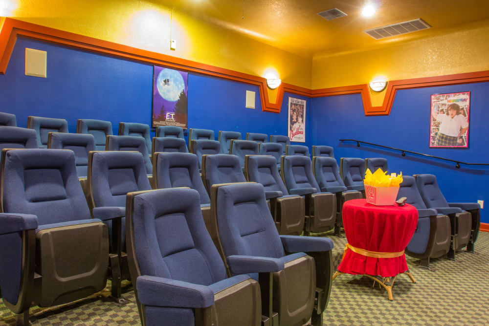Onsite movie theater with stadium seating at The Lodge at River Park in Fort Worth, Texas