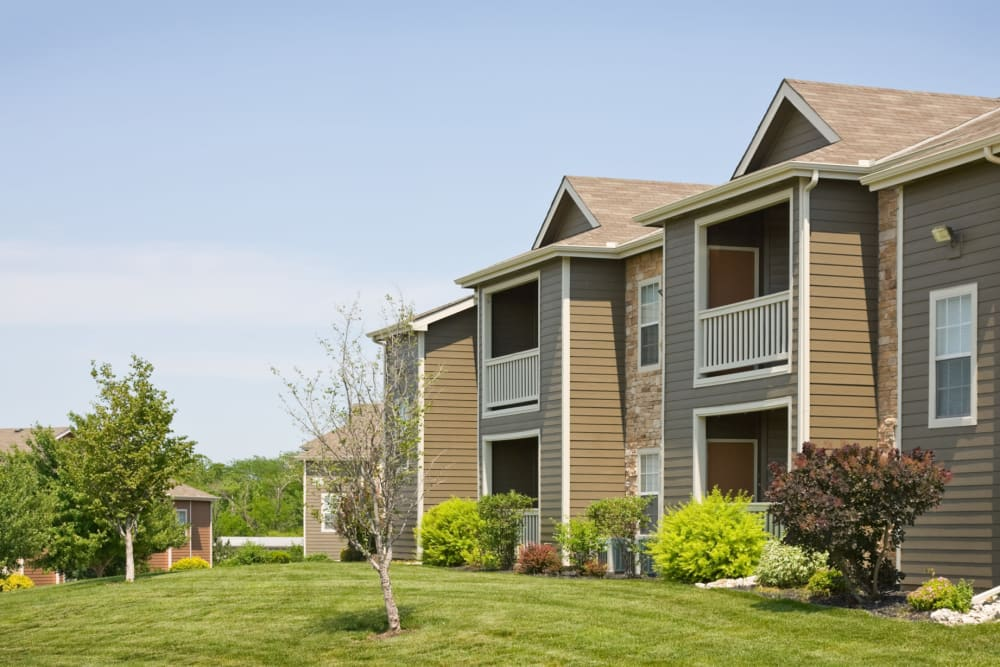 Professionally maintained landscaping outside resident buildings at Timber Lakes Apartment Homes in Kansas City, Missouri