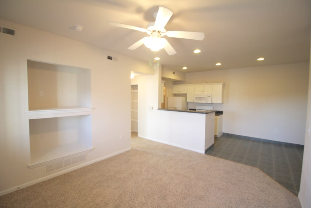 Plush carpeting and a ceiling fan in an apartment home at Timber Lakes Apartment Homes in Kansas City, Missouri