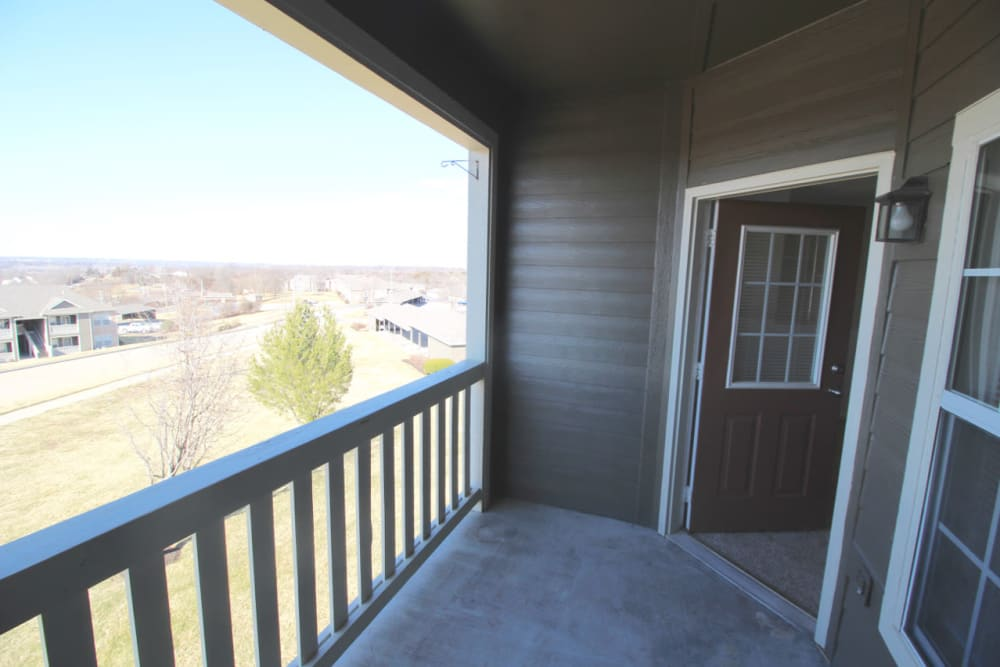 Private balcony with a view outside a model home at Timber Lakes Apartment Homes in Kansas City, Missouri