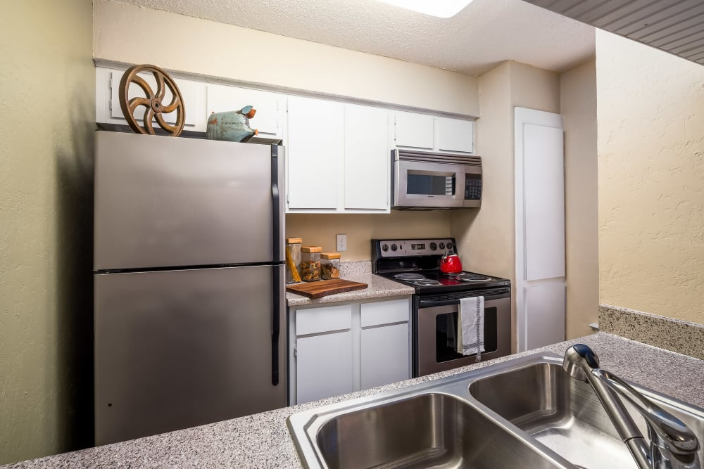 Kitchen with stainless-steel appliances at The Fairway Apartments in Plano, Texas