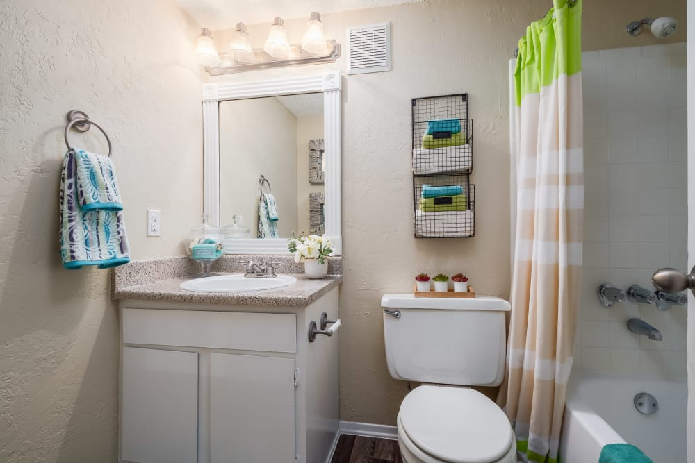 Bathroom with an oval tub at The Fairway Apartments in Plano, Texas