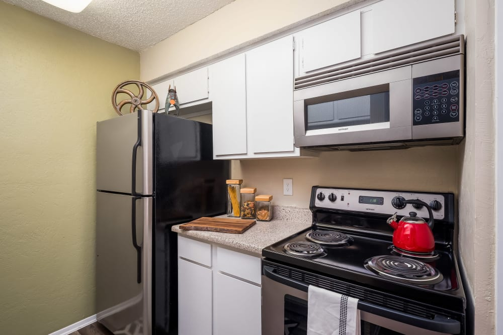 Kitchen with plenty of cabinetry at The Fairway Apartments in Plano, Texas