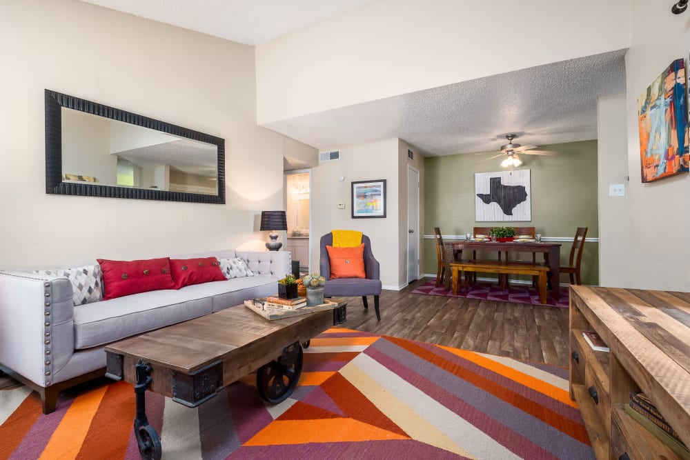 Large spacious living room with wood-style flooring at The Fairway Apartments in Plano, Texas