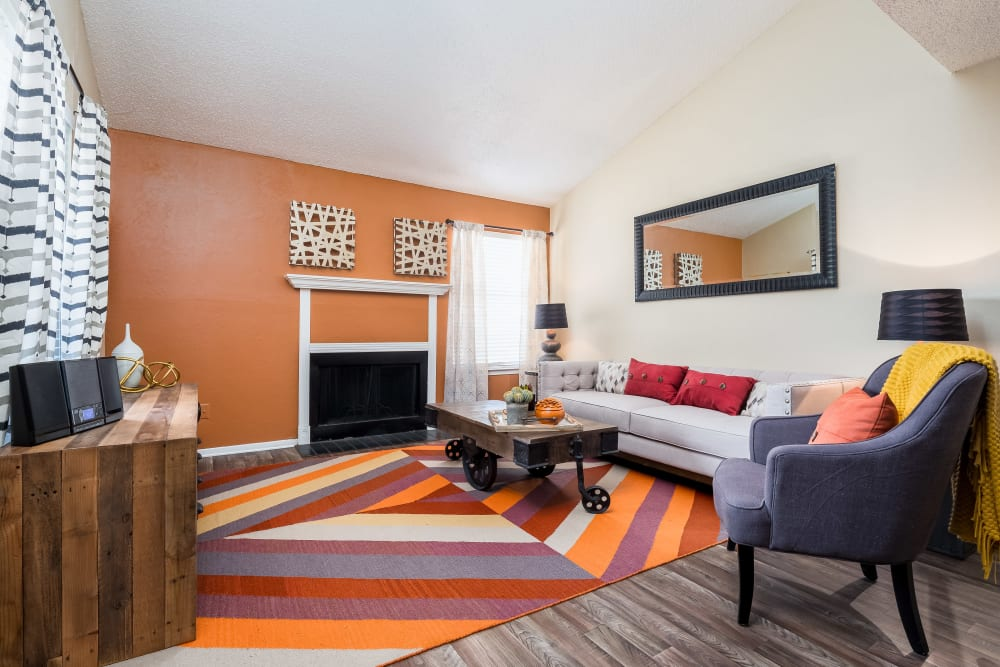Living room with an accent wall at The Fairway Apartments in Plano, Texas
