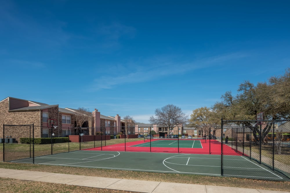 Tennis court for resident use at The Fairway Apartments in Plano, Texas