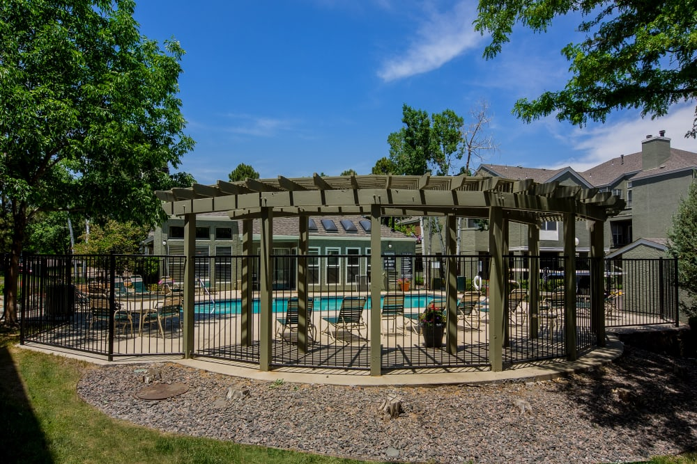 Pergola provides some shade near the pool at Waterfield Court Apartment Homes in Aurora, Colorado