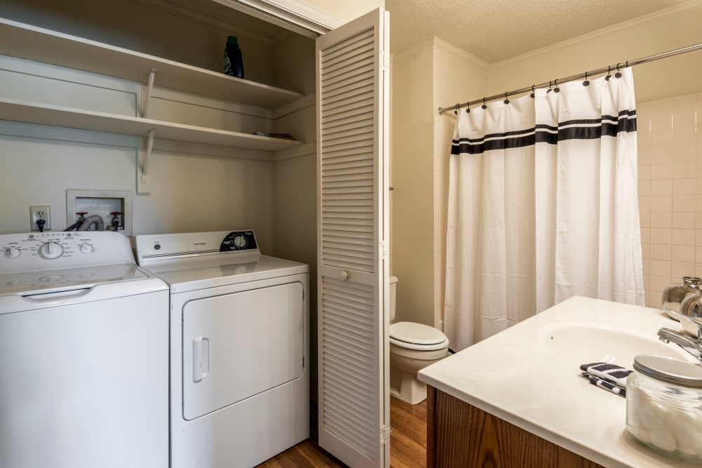 Large bathroom with washer and dryer at Coach House Apartments in Kansas City, Missouri