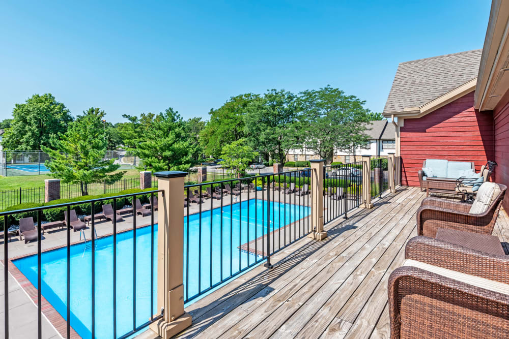 Resident pool with sun deck at Coach House Apartments in Kansas City, Missouri