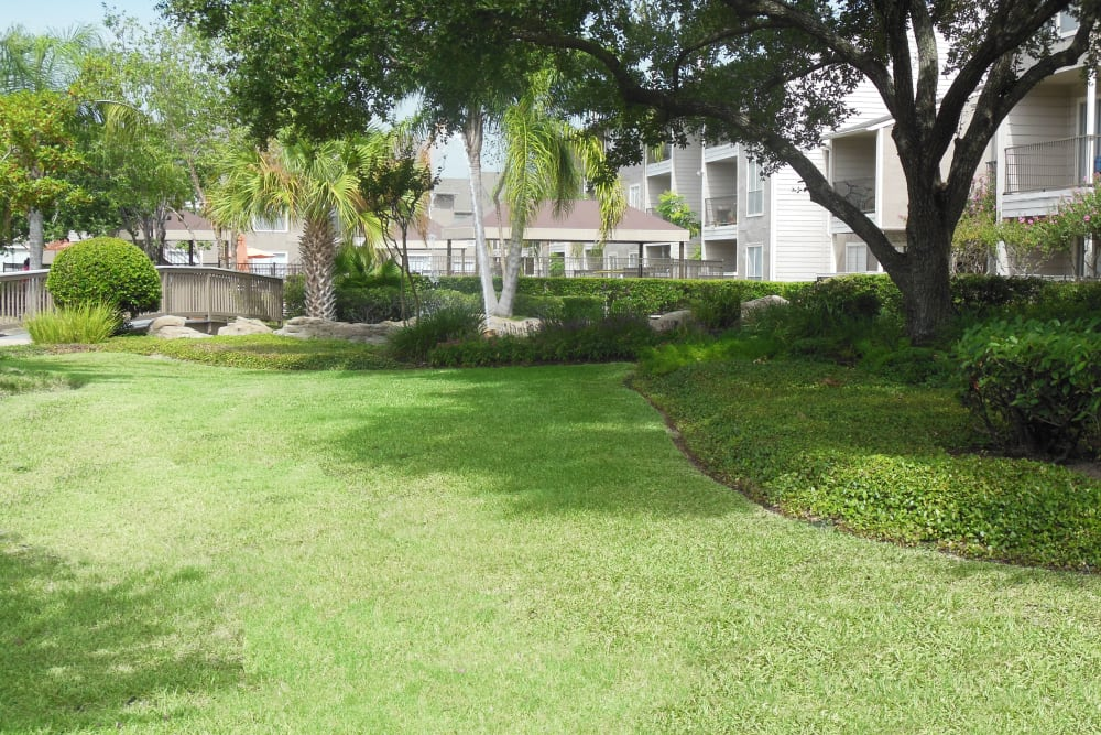 Professionally maintained landscaping outside resident buildings at Walden Pond in Houston, Texas