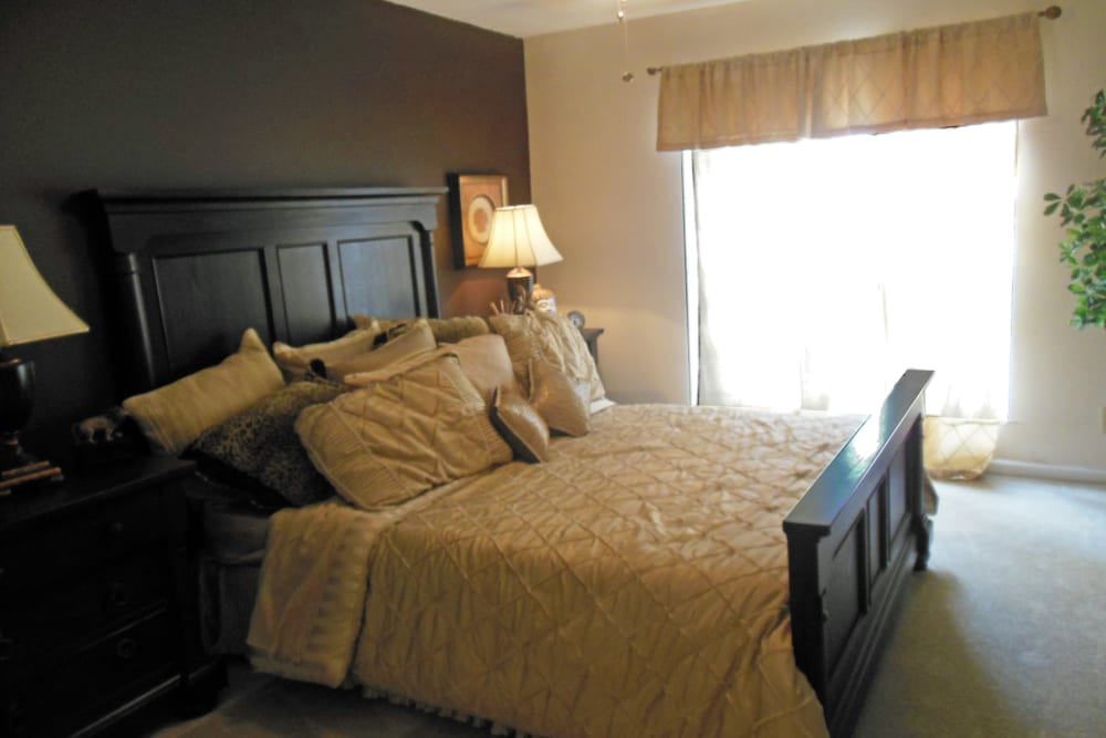 Well-furnished master bedroom in a model home at Walden Pond in Houston, Texas