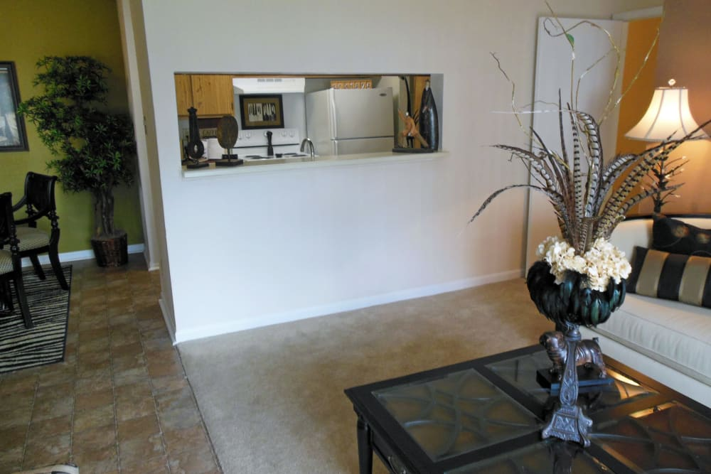 View of the dining area with an accent wall from the livings space of a model home at Walden Pond in Houston, Texas