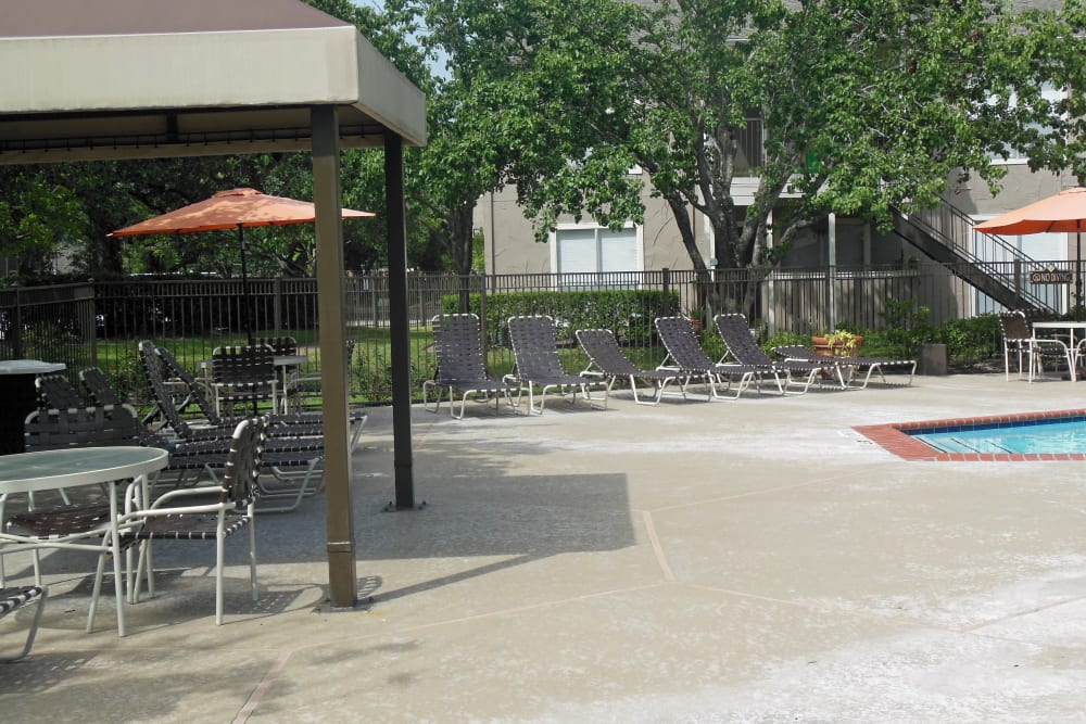 Plenty of shaded seating near the pool at Walden Pond in Houston, Texas