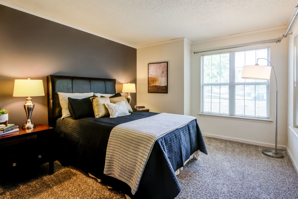 Large bedroom with natural light at Coach House Apartments in Kansas City, Missouri