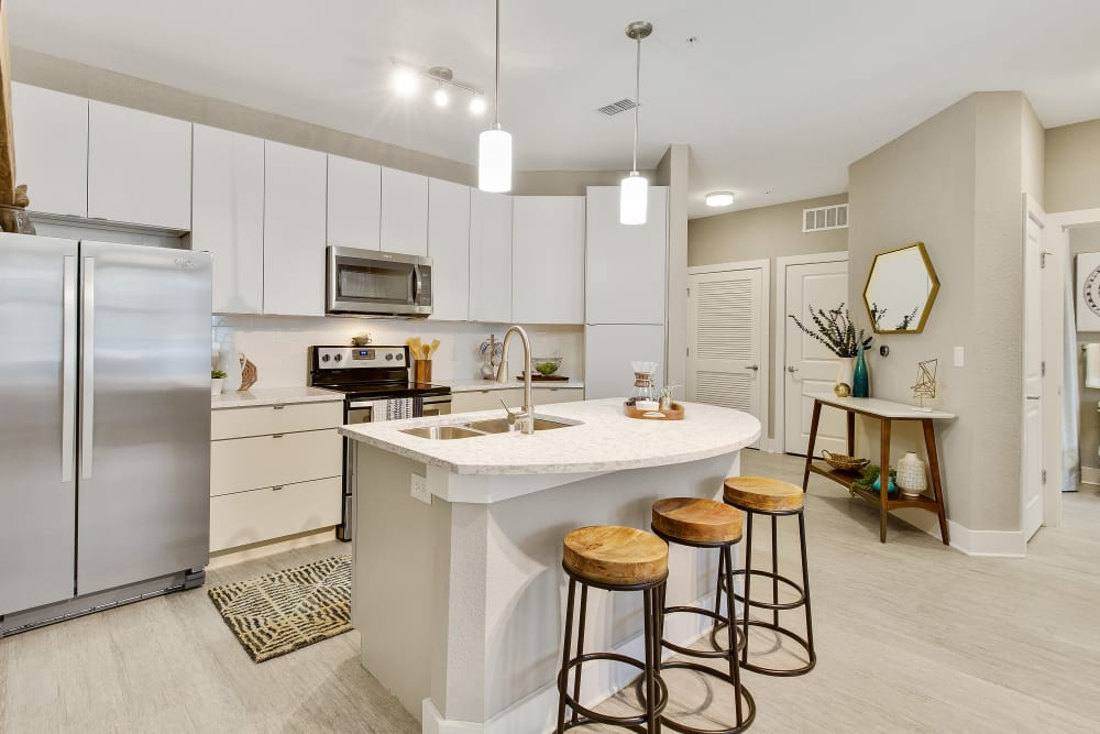 Modern kitchen and island bar at Sky Terrace Townhomes in Stafford, Virginia managed by Hercules Living.