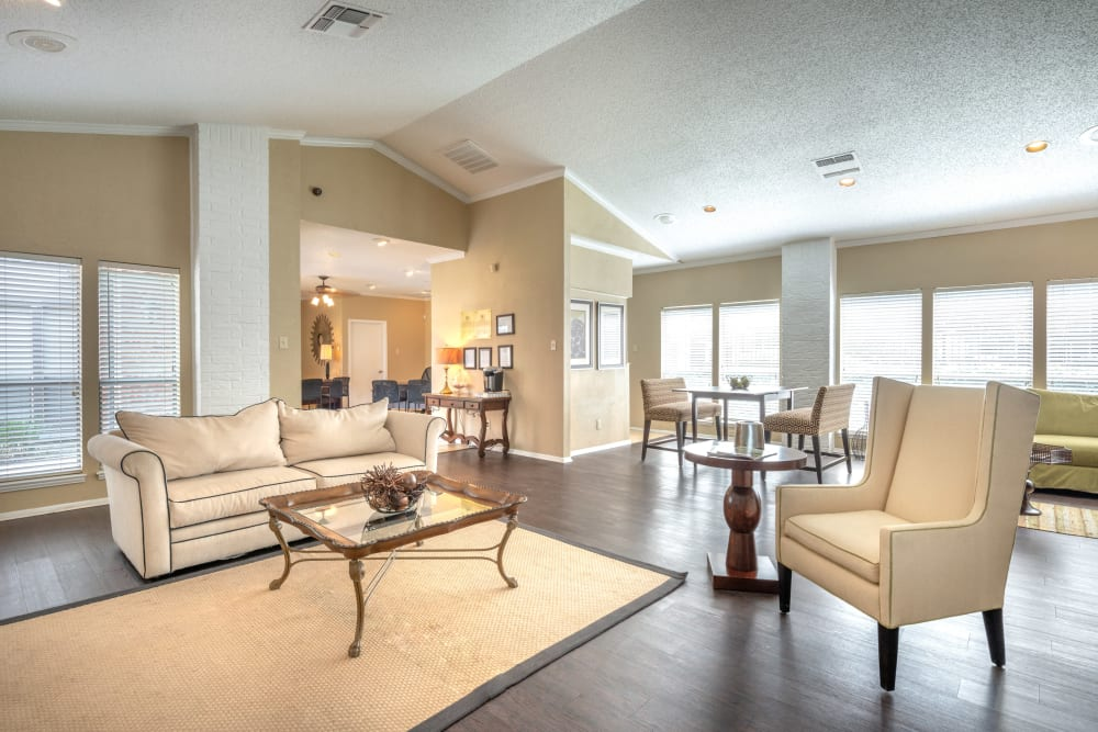 Well-furnished resident clubhouse interior at The Madison in Dallas, Texas