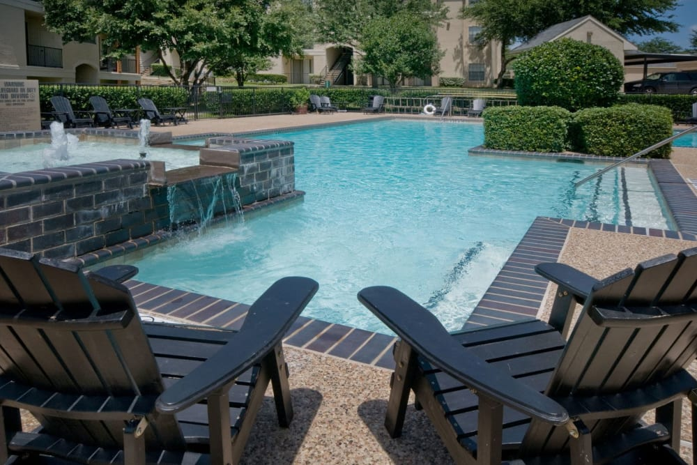 Lounge chairs near the pool at Rockbrook Creek in Lewisville, Texas
