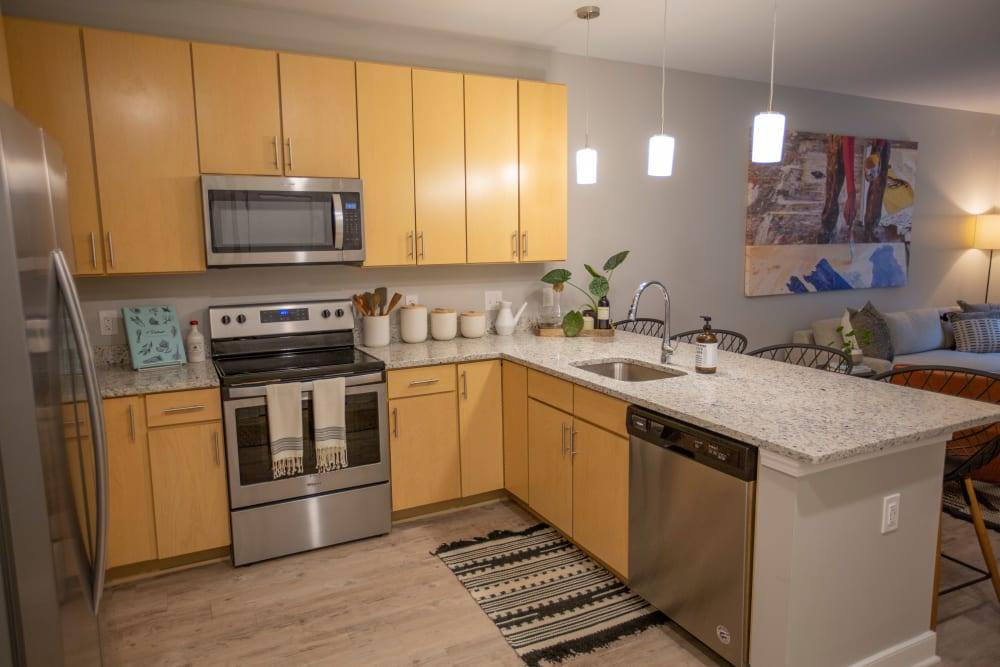 Kitchen with wood cabinets at The Boulevard in Detroit, Michigan