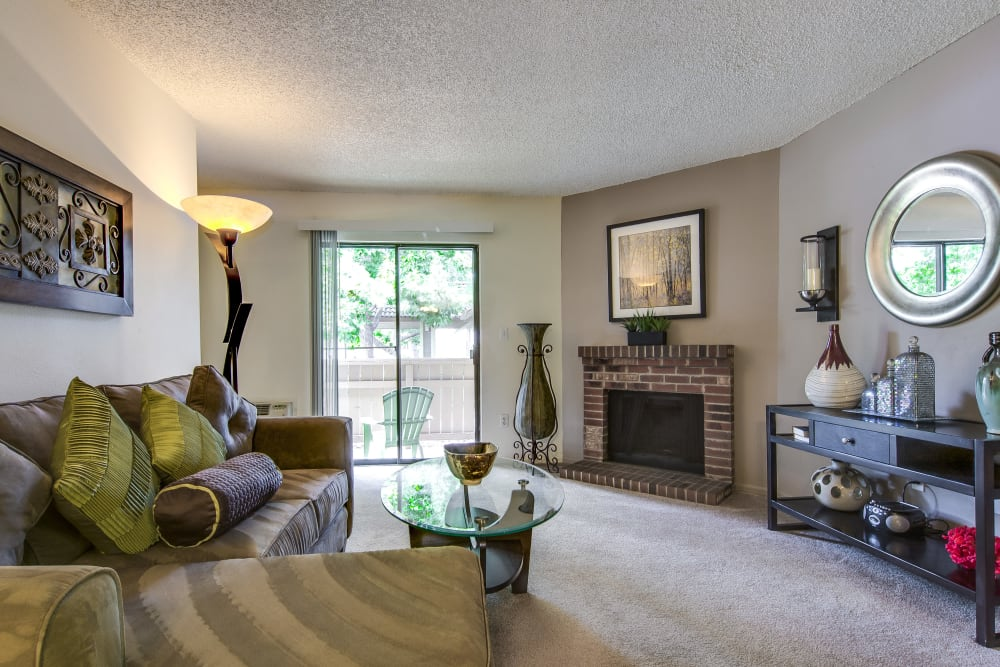 Plush carpeting and a fireplace in a model home's living area at Santana Ridge in Denver, Colorado
