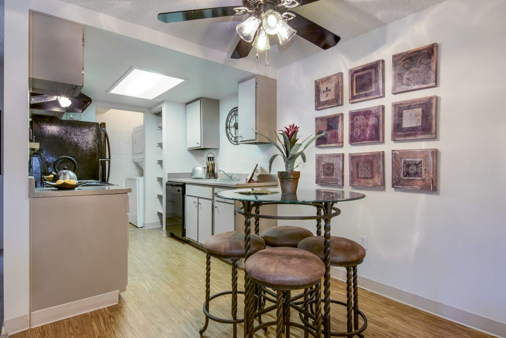 Ceiling fan over the dining area next to the kitchen in an open-concept floor plan at Santana Ridge in Denver, Colorado