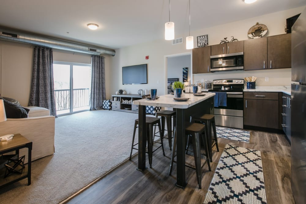 Kitchen with wood-style flooring at Park West 205 Apartment Homes in Pittsburgh, Pennsylvania