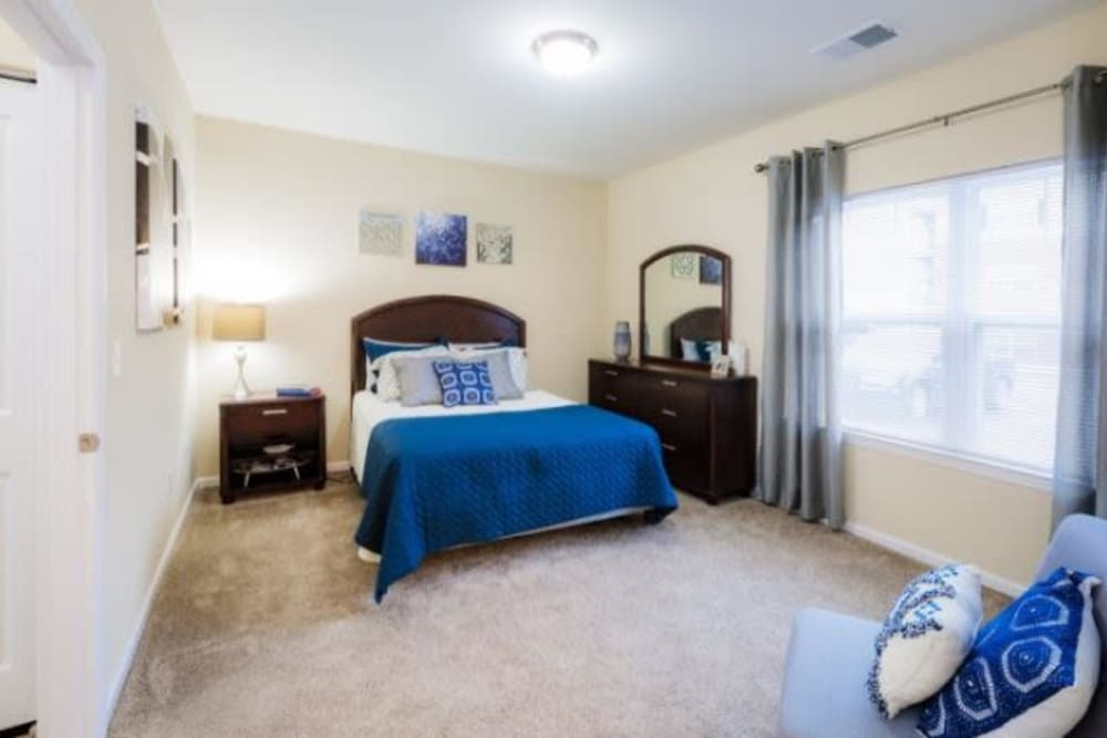 Bright master bedroom at Torrente Apartment Homes in Upper St Clair, Pennsylvania