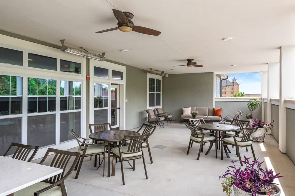 Covered patio with ceiling fans at Anthology of Wildwood in Wildwood, Missouri.