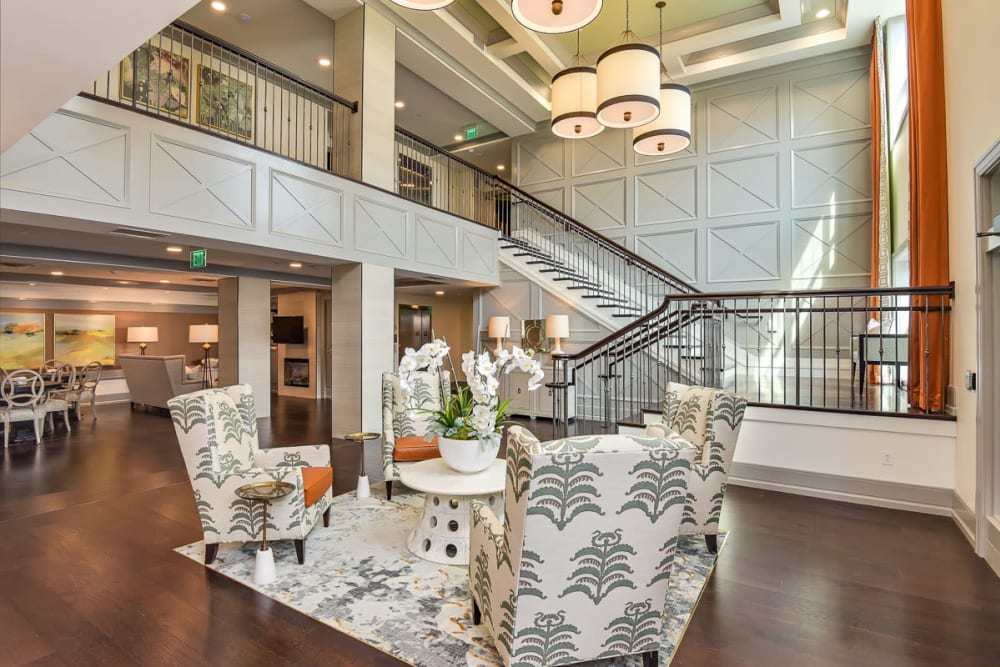 Seating area and a large staircase at Anthology of Wildwood in Wildwood, Missouri