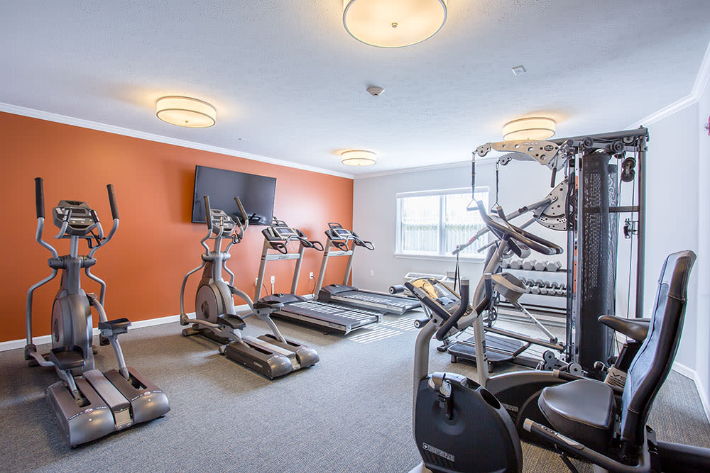 Well-lit Fitness center at Villa Capri Senior Apartments in Rochester, New York