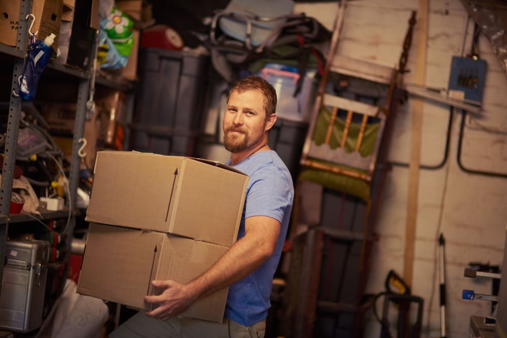 Man preparing items for storage at AAA Alliance Self Storage in Yuma, Arizona