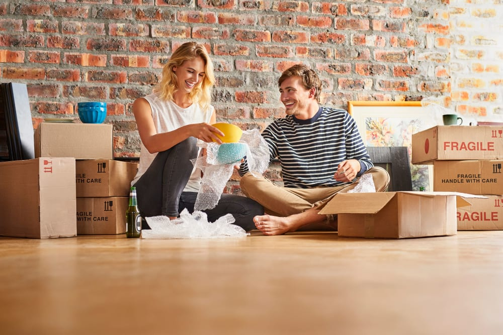Couple sitting in the living room with boxes ready for storage at AAA Alliance Self Storage in Yuma, Arizona