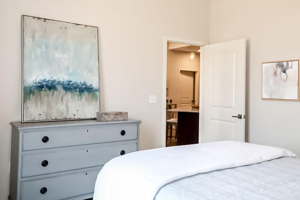 Well decorated bedroom at The Station at River Crossing in Macon, Georgia