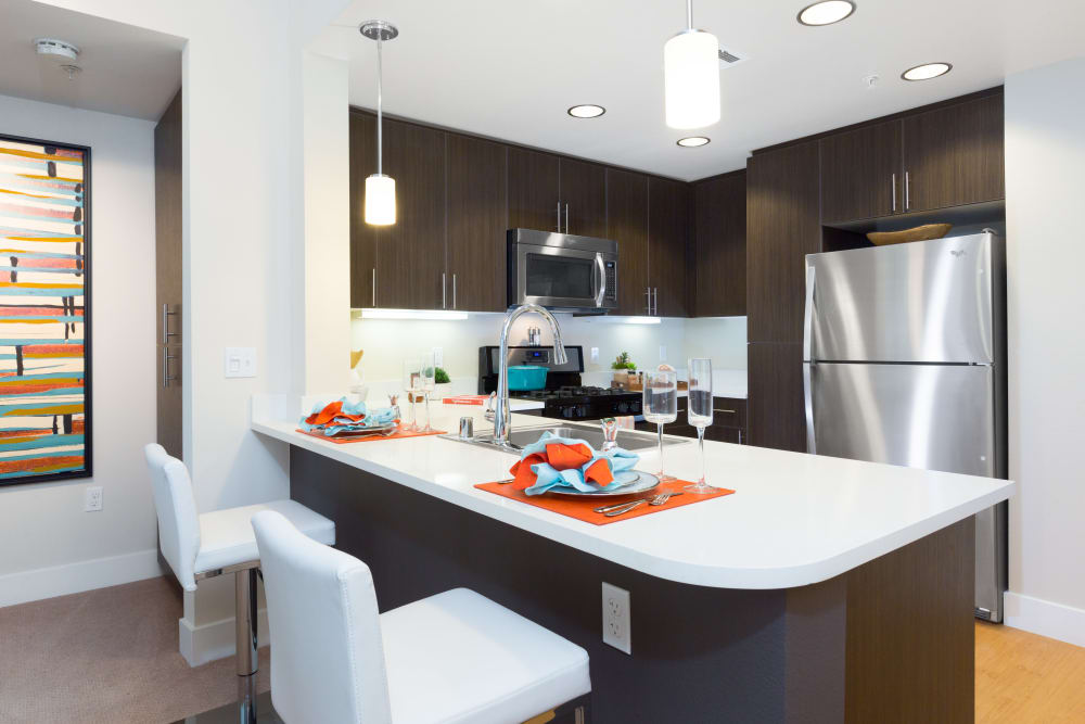 Beautiful kitchen with a large breakfast bar at Sofi Riverview Park in San Jose, California