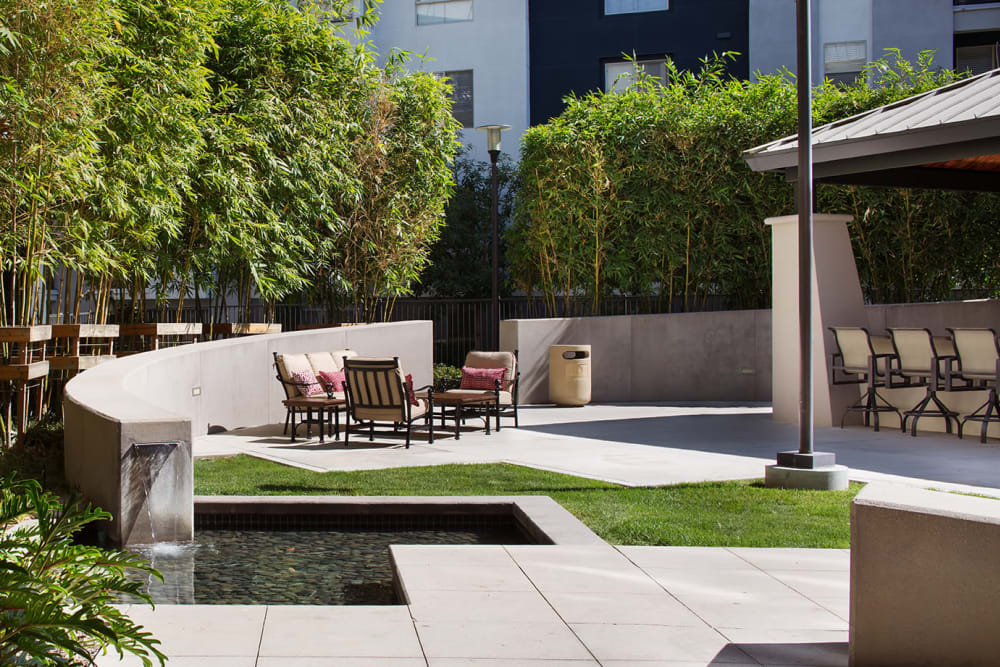 Water feature around a comfortably decorated outdoor lounge area at Sofi Warner Center in Woodland Hills, California