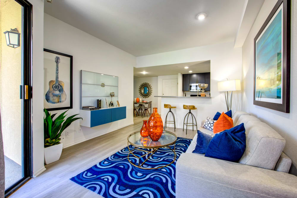 Modern decor in the living area of an open-concept floor plan at Sofi at 3rd in Long Beach, California