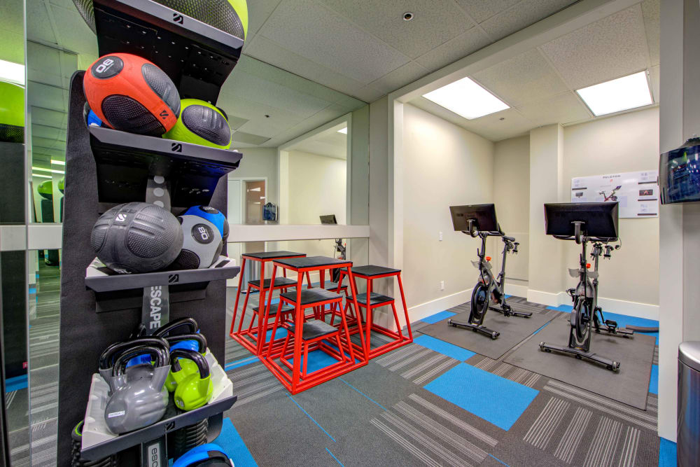Plenty of workout equipment, including Peloton bikes, in the fitness center at Sofi at 3rd in Long Beach, California