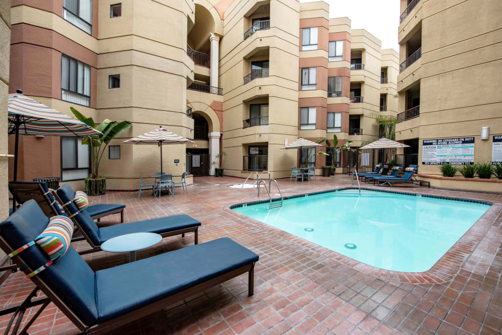 Pool in the courtyard with comfortable seating nearby at Sofi at 3rd in Long Beach, California