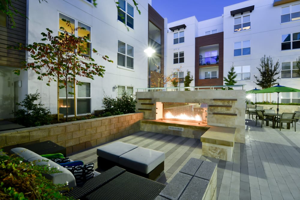 Outdoor gas-fueled fireplace with comfortable seating at Domus on the Boulevard in Mountain View, California