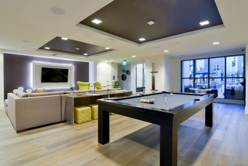 Resident clubhouse with a billiards table at Domus on the Boulevard in Mountain View, California