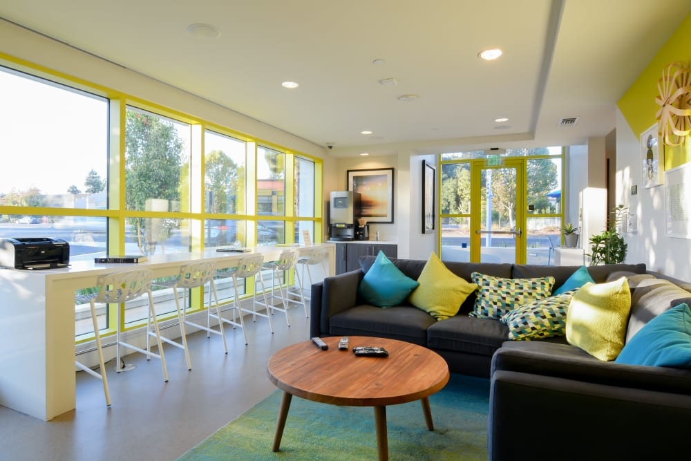 Resident clubhouse with with plenty of seating at Domus on the Boulevard in Mountain View, California