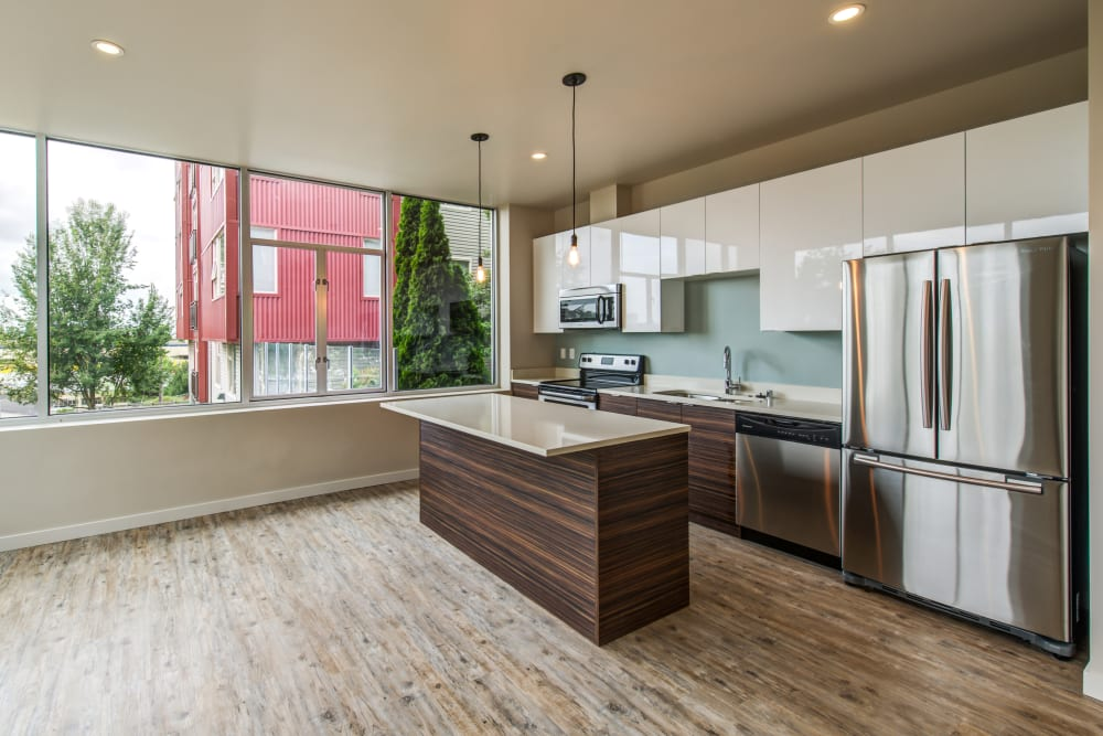 Kitchen with an island in a model home at Verse Seattle in Seattle, Washington